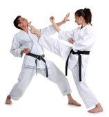 karate. mladé dívky a muži v kimonu. Bitva sportovní zachytávání