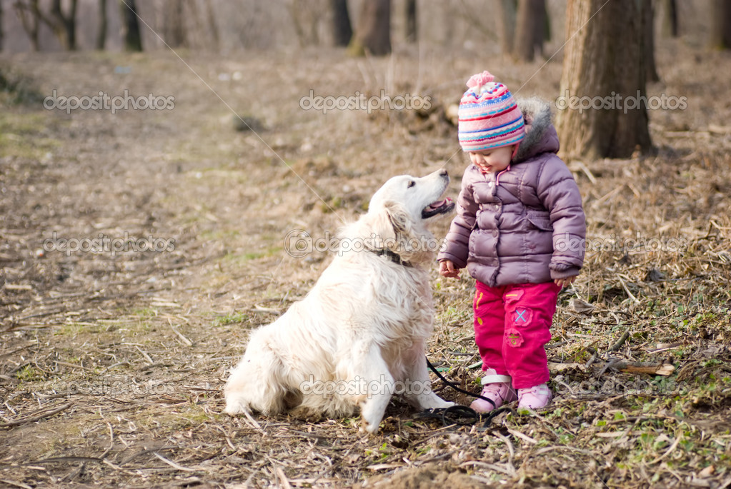 Girl with golden retriever