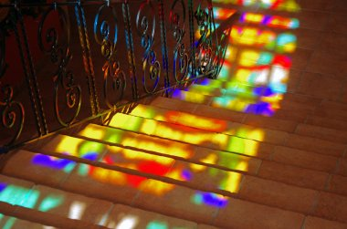 Spots of colored light on the stairs.