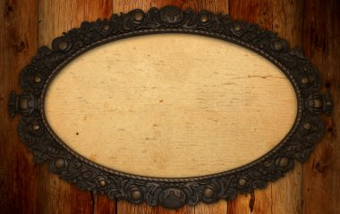 Antique frame with blank paper on knotty wood wall