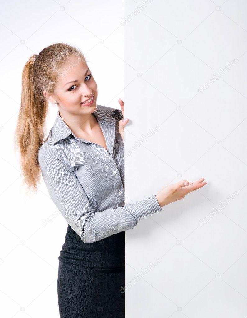 Businesswoman standing behind blank whits billboard