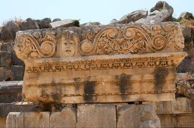 Ancient masks in Myra. Turkey.