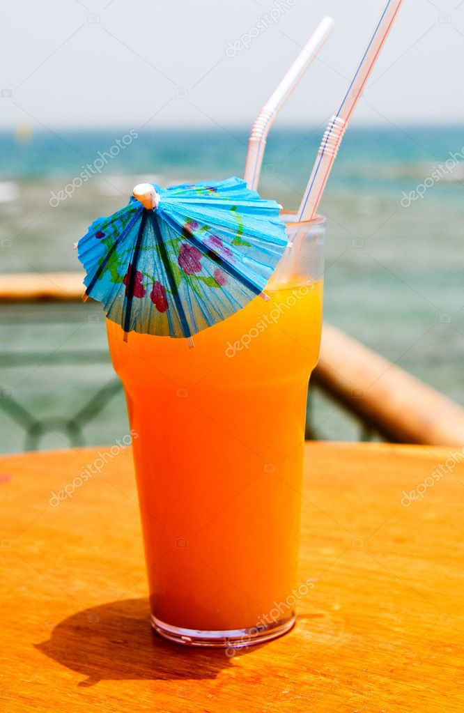 Tasty Cocktail With Paper Umbrella Against Red Sea Stock Photo