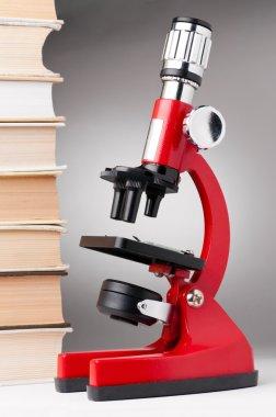 Books and microscope