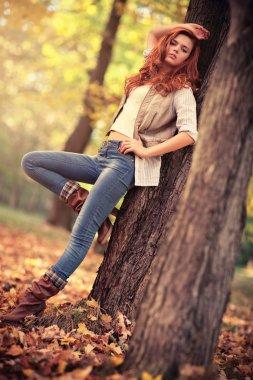 Young slim woman autumn portrait