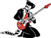 kočka hraje na elektrickou kytaru