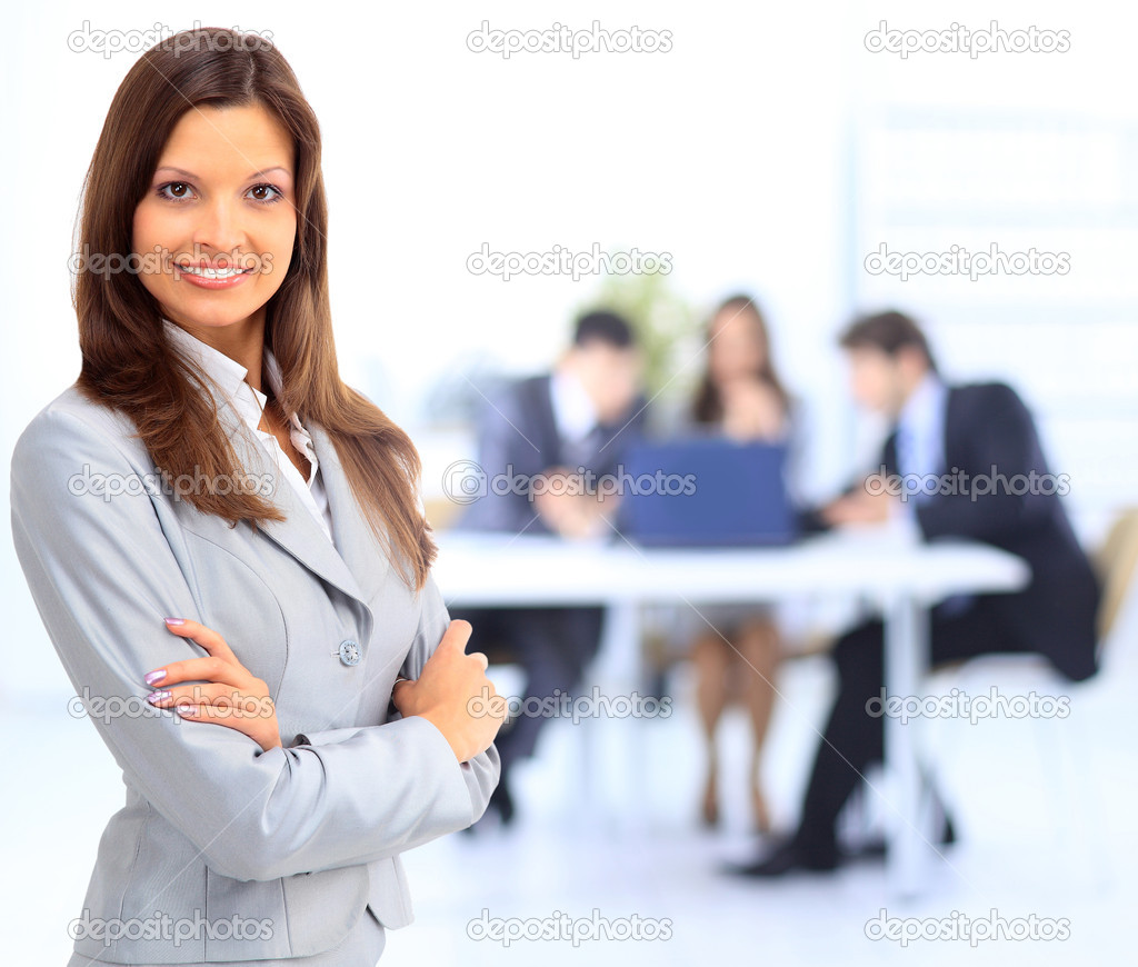 Portrait of beautiful businesswoman in office with colleagues