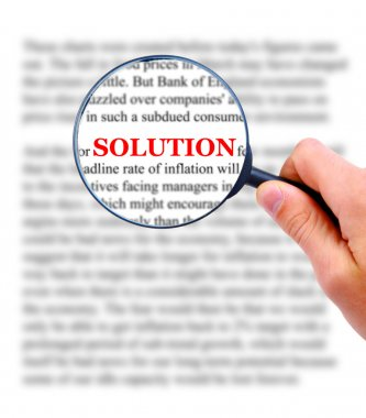 Magnifying glass in hand and word solution