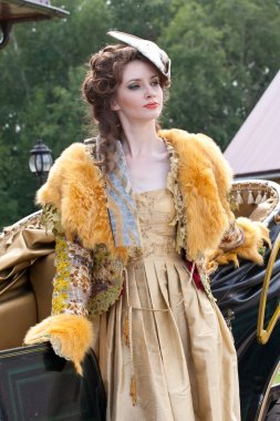 The young woman in clothes of 18 centuries
