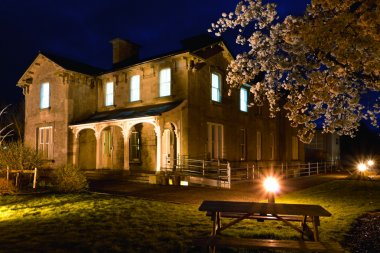 Old Railway Hotel at night and cherry blossom