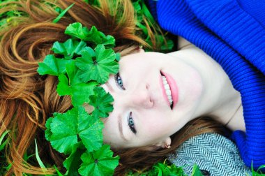 Redheaded girl with crown from leaves