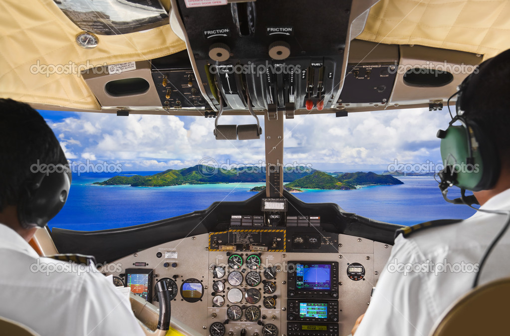 Pilots in the plane cockpit and island
