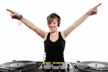 Young girl DJ posing at the turntables