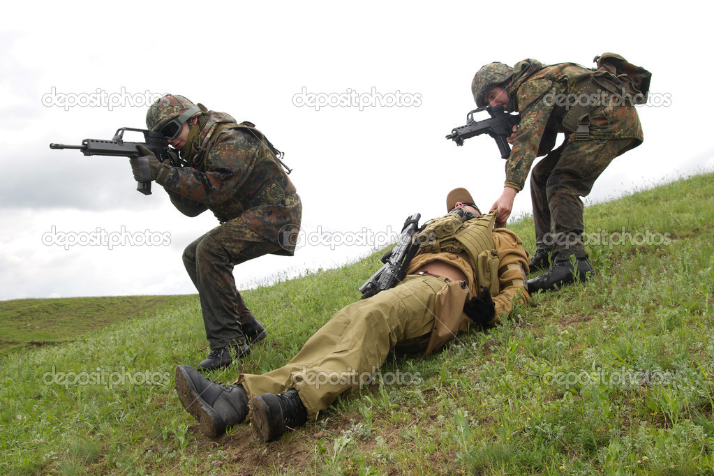 Soldiers saving their wounded partner