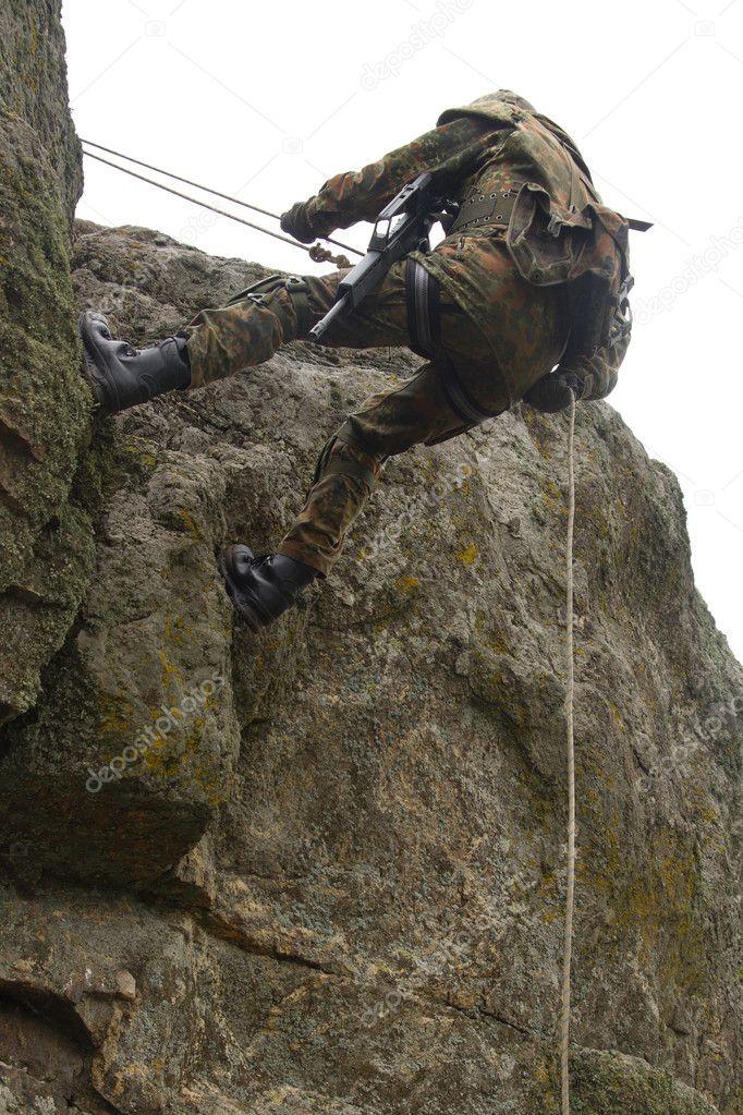 https://static6.depositphotos.com/1000904/566/i/950/depositphotos_5667549-stock-photo-dangerous-military-alpinism.jpg