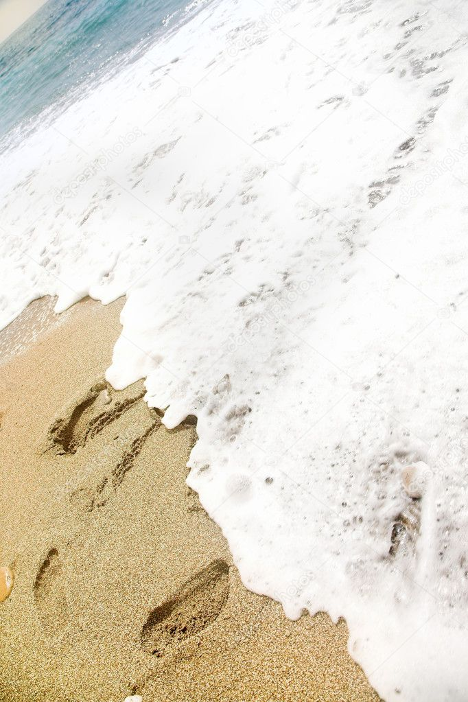 Foot steps on beach