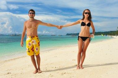 Beautiful couple on a tropical beach stock vector