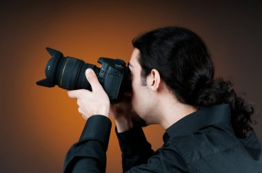 Photographer with the digital camera stock vector
