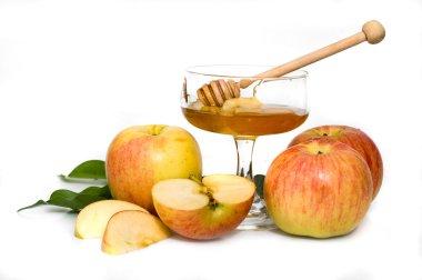 Isolated honey with ripe fresh apple for Rosh Hashana