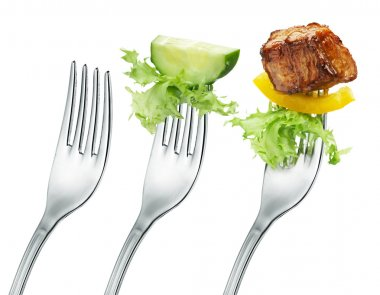 Fresh cucumber, meat and salad on a fork