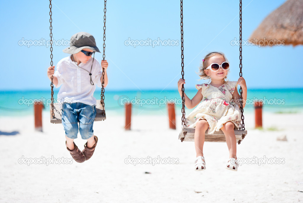 Little kids swinging