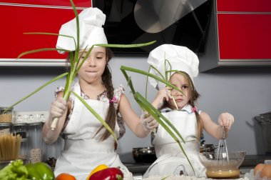 Two little girl cook