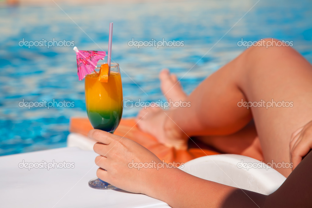Woman hand with cocktail glass