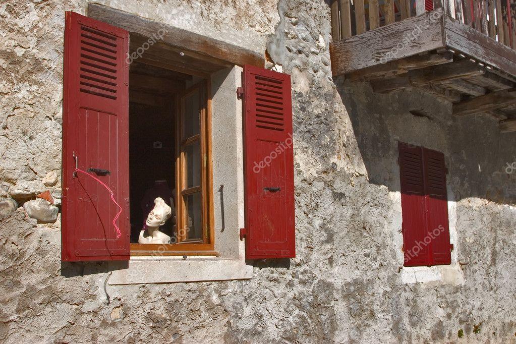 Dummy in a red window.