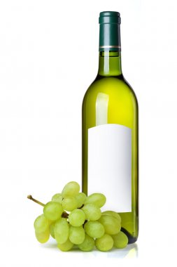 White wine in green bottle with blank label and grapes