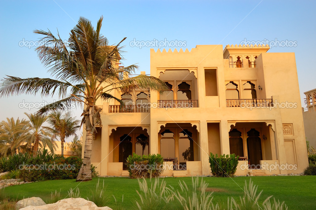The Arabic style villa and palm during sunset at luxury hotel, D