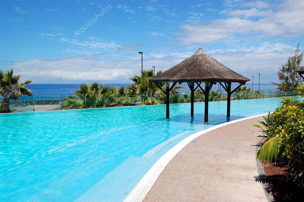 Swimming pool with Bali type hut and beach of luxury hotel, Tene