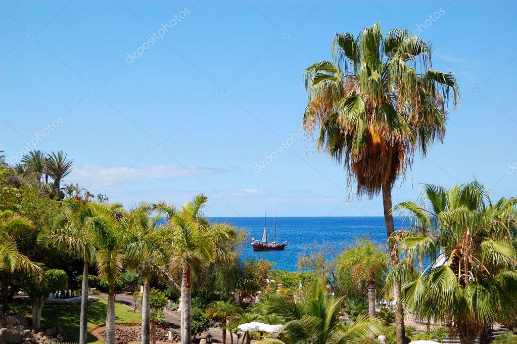 Beach at luxury hotel and sail yacht, Tenerife island, Spain