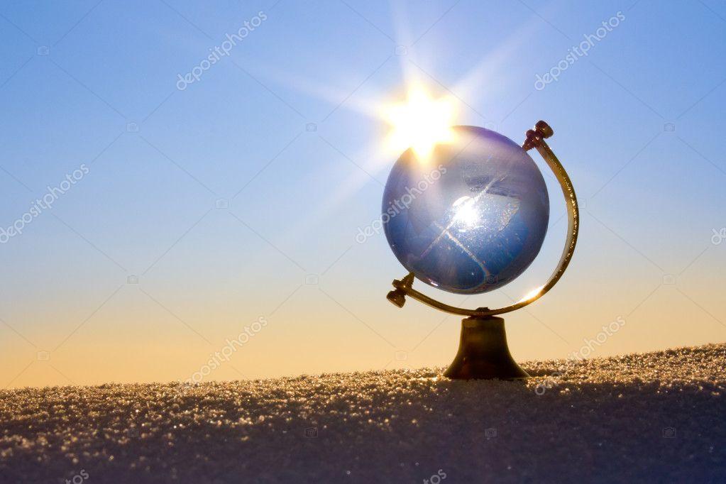 Glass globe in the snow.