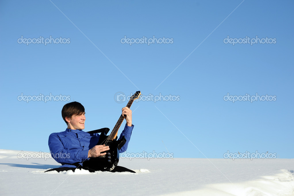 Young active teenager with guitar