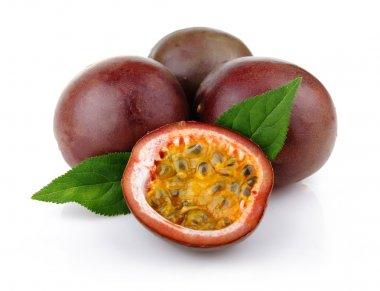 Fresh passion fruit with green leaves isolated