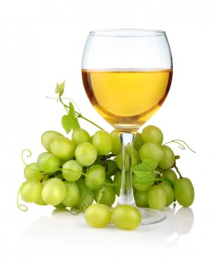 Glass of wine and grape branch isolated on white