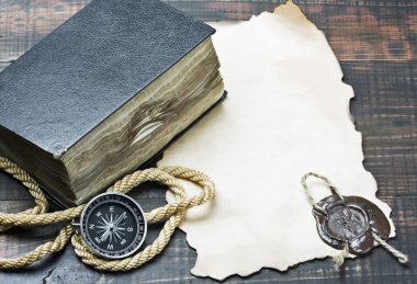 Compass and an old book