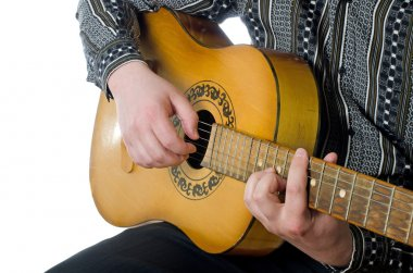 The man plays an acoustic guitar