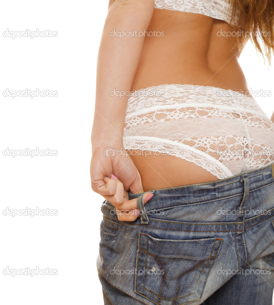 Female back in jeans and white lace panties