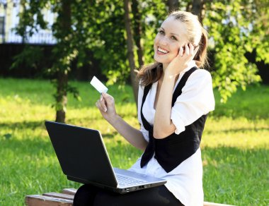 Beautiful Woman with Credit Card Using Her Laptop