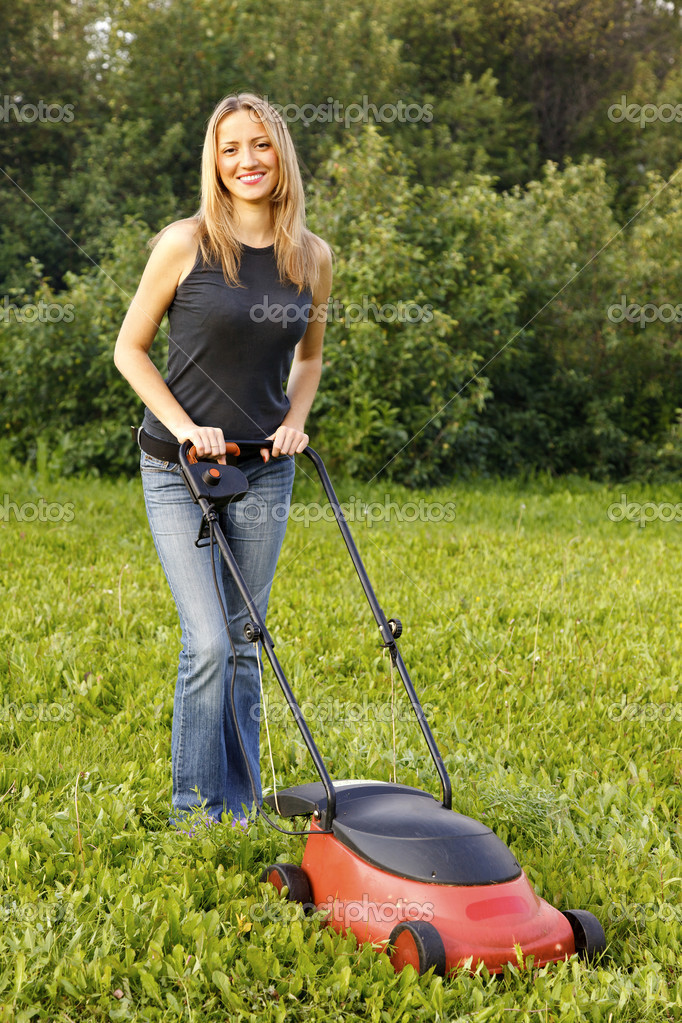 Woman mowing with lawn mower