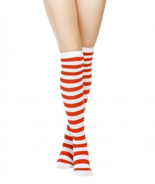 Woman legs in color red socks isolated on white