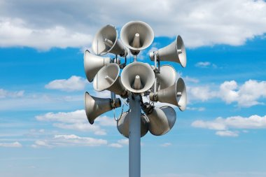 A bunch of loudspeakers against cloudy blue sky stock vector