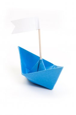 Papper blue origami boat with flag