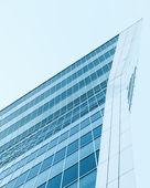 Modern blue glass skyscraper perspective view