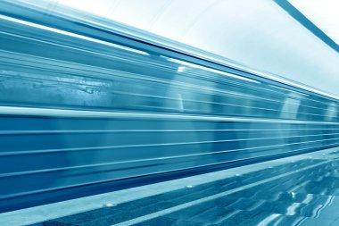 Moving train on underground station