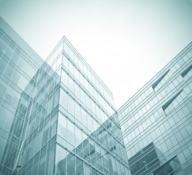 Business background of glass and metallic modern architecture in