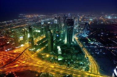 Panorama Dubai city at night.
