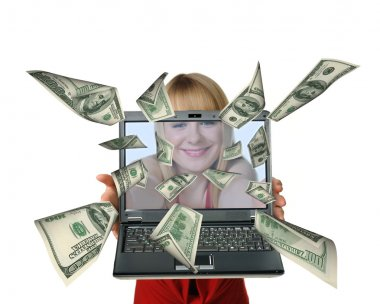 The woman with the laptop in hands and fly out dollars