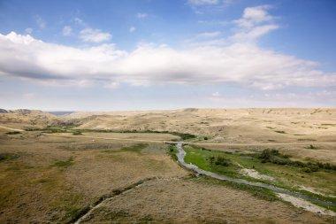 A saskatcheawn landscape in creek hills stock vector